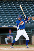 Brandon Dulin #13 of the AZL Royals bats against the AZL Rangers at Surprise Stadium on July 15, 2013 in Surprise, Arizona. AZL Rangers defeated the AZL Royals, 3-2. (Larry Goren/Four Seam Images)