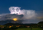 Pictured:  A storm in Dolenja vas, Slovenia<br /> <br /> Lightning from a huge supercell storm strikes the ocean and illuminates the sky as boats float on the calm water.  In another image enormous clouds gather over a city as they crackle with forks of electric light.<br /> <br /> The supercells can last for up to ten hours and can cause devastating tornadoes and torrential hailstone-filled thunderstorms.  The stunning images were taken in Padova and Trieste in Italy and in Ljubljana, Dloneja vas and Crni Kal in Slovenia by weather information supervisor and amateur photographer Marko Korosec.  SEE OUR COPY FOR DETAILS.<br /> <br /> Please byline: Marko Korosec/Solent News<br /> <br /> © Marko Korosec/Solent News & Photo Agency<br /> UK +44 (0) 2380 458800