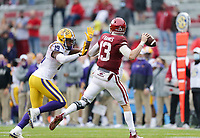 Arkansas quarterback Feleipe Franks (13) throws a pass under pressure by LSU linebacker Jabril Cox (19), Saturday, November 21, 2020 during the fourth quarter of a football game at Donald W. Reynolds Razorback Stadium in Fayetteville. Check out nwaonline.com/201122Daily/ for today's photo gallery. <br /> (NWA Democrat-Gazette/Charlie Kaijo)