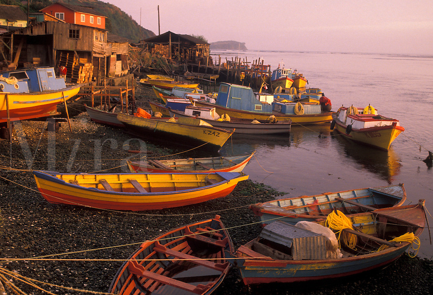 AJ2096, boats, Chile, Chiloe Island, Colorful fishing boats beached at low tide at sunrise in the harbor in Ancud on the Pacific Ocean on Chiloe Island in Chile.