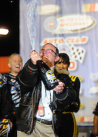 Feb 22, 2009; Fontana, CA, USA; NASCAR Sprint Cup Series car owner Jack Roush celebrates with champagne after driver Matt Kenseth (not pictured) won the Auto Club 500 at Auto Club Speedway. Mandatory Credit: Mark J. Rebilas-