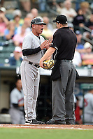 Indianapolis Indians manager Dean Treanor (27) argues a call with umpire Brad Myers during a game against the Rochester Red Wings on July 26, 2014 at Frontier Field in Rochester, New  York.  Rochester defeated Indianapolis 1-0.  (Mike Janes/Four Seam Images)