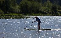 Paddleboarder, Northwest Paddling Festival 2016, Lake Sammamish State Park, Issaquah, WA, USA.
