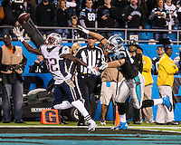 The Carolina Panthers play the New England Patriots at Bank of America Stadium in Charlotte North Carolina on Monday Night Football.  The Panthers defeated the Patriots 24-20.  New England Patriots free safety Devin McCourty (32) goes after a pass intended for Carolina Panthers tight end Greg Olsen (88)