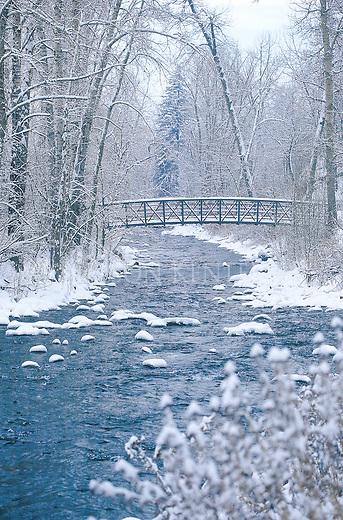 Winter scene with the footbridge over Rattlesnake Creek in Missoula, Montana