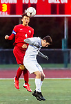 CHESHIRE, CT-111220JS14—Cheshire's Ethan Gonzalez (4) heads the ball in front of North Haven's Eduardo Cienfuegos de Paz  (18) during their SCC Division A semifinal game Thursday at Cheshire High School.<br /> Jim Shannon Republican-American
