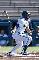 Michigan Wolverines outfielder Clark Elliott (15) follows through on his swing during the NCAA baseball game against the Illinois Fighting Illini on March 20, 2021 at Fisher Stadium in Ann Arbor, Michigan. Michigan won the game 8-1. (Andrew Woolley/Four Seam Images)