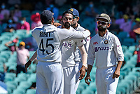 9th January 2021; Sydney Cricket Ground, Sydney, New South Wales, Australia; International Test Cricket, Third Test Day Three, Australia versus India; Rohit Sharma of India congratulates Mohammed Siraj of India after the wicket of Will Pucovski of Australia