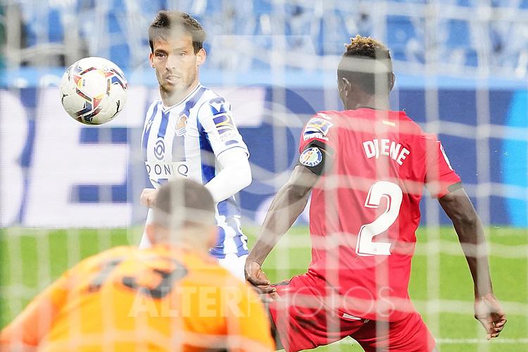 Real Sociedad's David Jimenez Silva (c) and Getafe CF's David Soria (l) and Djene Dakonam during La Liga match. October 3, 2020. (ALTERPHOTOS/Acero)