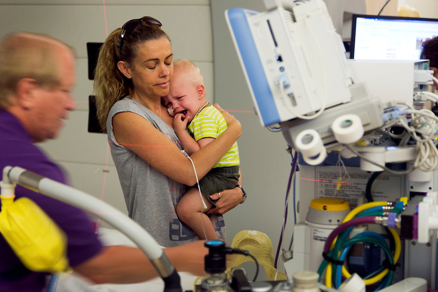 Jayden Stone (2) is comforted by mother Leisl as he is prepared for his daily treatment. Jayden and his family have relocated to Chicago where he is receiving proton beam therapy to battle his aggressive brain tumour.