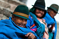 """Old women, wearing blue ponchos, watch a procession during the Inti Raymi celebration in Pichincha province, Ecuador, 26 June 2010. Inti Raymi, """"Festival of the Sun"""" in Quechua language, is an ancient spiritual ceremony held in the Indian regions of the Andes, mainly in Ecuador and Peru. The lively celebration, set by the winter solstice, goes on for various days. The highland Indians, wearing beautiful costumes, dance, drink and sing with no rest. Colorful processions in honor of the God Inti (Sun) pass through the mountain villages giving thanks for the harvest and expressing their deep relation to the Mother Earth (Pachamama)."""