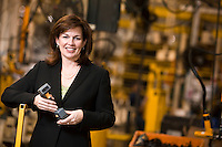 """Alumni Profile: Portrait of Lafayette College Alum Sherry Welsh, Vice President of Global Sales for auto parts maker Arvin Meritor. Here she is standing on the """"Cradle Assembly Line where the front suspension module  for Jeeps are made....4373...........................................................................................................................................................................................................................................................................................................................................................................................................4372"""