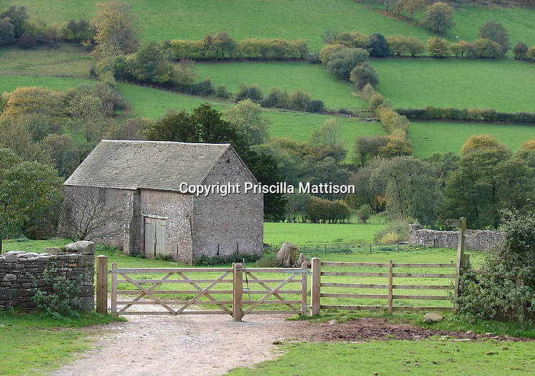 Llanthony, Wales - November 2, 2006:  A stone barn stands below green hills in the Vale of Ewyas.