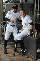 Staten Island Yankees infielder Eric Jagielo (14) and manager Justin Pope (22) during game against the State College Spikes at Richmond County Bank Ballpark at St.George on August 8, 2013 in Staten Island, NY.  Staten Island defeated State College 6-5.  (Tomasso DeRosa/Four Seam Images)