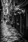 A wet day in the alleyways of Corfu Town on the island of Corfu in Greece.