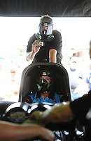 Apr. 29, 2011; Baytown, TX, USA: NHRA funny car driver Brian Thiel and crew member Jason Sharp during qualifying for the Spring Nationals at Royal Purple Raceway. Mandatory Credit: Mark J. Rebilas-