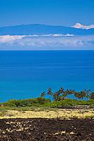 A lava field and Kiholo Bay along the Kohala Coast of the Big Island, with Maui's Haleakala in the distance.