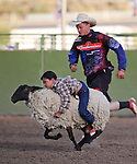Jayden Smart, of Reno, competes in the Mutton Bustin' portion of the Smackdown Tour Bull Riding event at Fuji Park in Carson City, Nev., on Saturday, June 7, 2014.<br /> Photo by Cathleen Allison