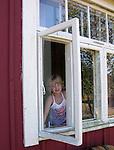 Child in Window on Island of Kökar, Åland, Finland