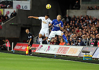 Pictured L-R: Jefferson Montero of Swansea battles for a header against Ritchie De Laet of Leicester City. Saturday 25 October 2014<br />