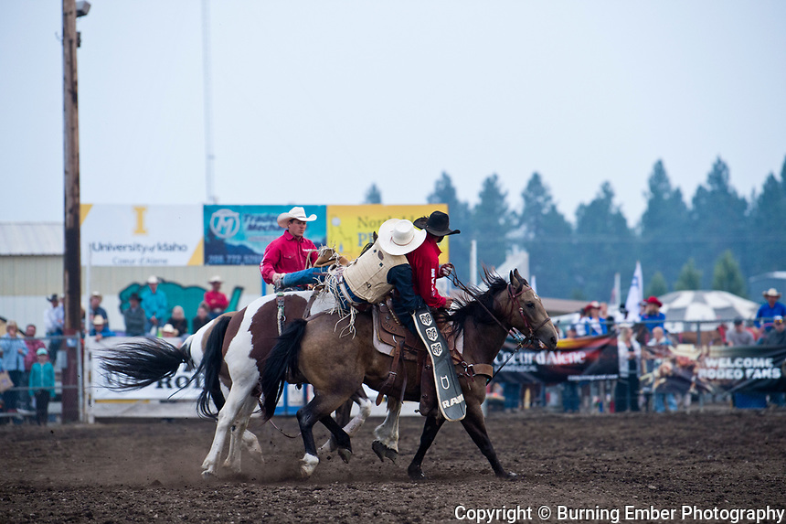 JC DeSaveur on Corey & Lange's bucking horse Picture Perfect during the Saddle Bronc Event during the 2nd perf at the Gem State Stampede August 25th, 2018 2nd perf in Couer D'Alene ID.  Photo by Josh Homer/Burning Ember Photography.  Photo credit must be given on all uses.