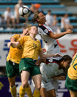 USWNT forward (20) Abby Wambach scores on a header over Australia's (16) Lauren Colthorpe and (19) Clare Polkinghorne during the Peace Queen Cup  in Suwon, South Korea.  The U.S. defeated Australia, 2-1, at the Suwon Sports Complex.