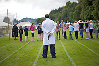 A judge holds a starting gun at a childrens' race at the Inveraray Highland Games, held at Inveraray Castle in Argyll.