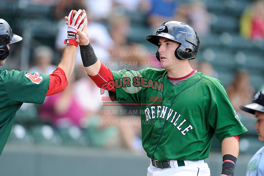 Catcher Jordan Procyshen (29) of the Greenville Drive is congratulated after scoring a run in a game against the Savannah Sand Gnats on Sunday, August 24, 2014, at Fluor Field at the West End in Greenville, South Carolina. Greenville won, 8-5. (Tom Priddy/Four Seam Images)