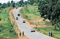 Kenya. Western Province. Lunyerere. Traffic on the concrete road near the fields.  © 2004 Didier Ruef