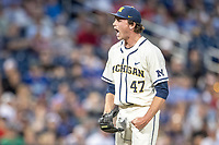 Michigan Wolverines pitcher Tommy Henry (47) celebrates recording a key strikeout against the Vanderbilt Commodores during Game 1 of the NCAA College World Series Finals on June 24, 2019 at TD Ameritrade Park in Omaha, Nebraska. Michigan defeated Vanderbilt 7-4. (Andrew Woolley/Four Seam Images)