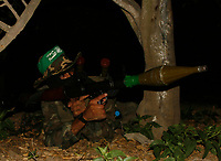 """Palestinian gunmen from Alqassam Brigads training after one day  of a cease fire, near the border with Israel, middle of Gaza strip in alburage refugee camp , Satruday, June 20, 2008. Guns went quiet as a six-month truce between Israel and Gaza Strip militants took effect early Thursday, marred only by widespread skepticism about its ability to hold. The cease-fire, which Egypt labored for months to conclude, aims to bring an end to a year of fighting that has killed seven Israelis and more than 400 Palestinians many of them civilians since the Islamic militant group Hamas wrested control of Gaza a year ago<br /> . """"photo by Thair Alhassany"""""""
