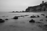 Greg and I headed out for a quick sunset shoot this day, only to find a thick marine layer completely blocking the sun.  But the cloudy sky turned out to be perfect for capturing the cove's beach and its bluffs in a more contemplative, moodier setting in black and white.  Using a long exposure smoothed out the waves and made the rocks look as though they're in a layer of mist, or visible underwater.