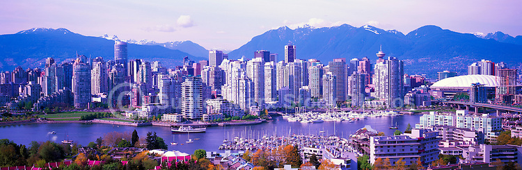 """City of Vancouver Skyline and Downtown at Yaletown and """"False Creek"""", British Columbia, Canada, in Spring.  The North Shore Mountains (Coast Mountains) rise above the City. - Panoramic View (Historical Roof on BC Place)"""