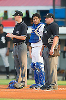 (L-R) Umpire Travis Eggert, Burlington Royals catcher Edul Escobar #11 and home plate umpire Jeremy Riggs prior to the start of the Appalachian League game against the Bristol White Sox at Burlington Athletic Stadium August 13, 2010, in Burlington, North Carolina.  Photo by Brian Westerholt / Four Seam Images
