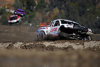 Dec. 18, 2009; Lake Elsinore, CA, USA; LOORRS unlimited four driver Carl Renezeder after a hard landing during qualifying for the Lucas Oil Challenge Cup at the Lake Elsinore Motorsports Complex. Mandatory Credit: Mark J. Rebilas-US PRESSWIRE