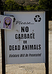 Sign in Tonasket, Washington State.  Sign reads NO GARBAGE or DEAD ANIMALS.  Located near public dumpster.