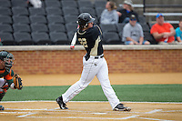 Will Craig (22) of the Wake Forest Demon Deacons follows through on his swing against the Miami Hurricanes at Wake Forest Baseball Park on March 22, 2015 in Winston-Salem, North Carolina.  The Demon Deacons defeated the Hurricanes 10-4.  (Brian Westerholt/Four Seam Images)