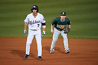 Siena Saints shortstop Tyler Martis (1) in the field behind Matt Morales (7) leading off second base during a game against the Stetson Hatters on February 23, 2016 at Melching Field at Conrad Park in DeLand, Florida.  Stetson defeated Siena 5-3.  (Mike Janes/Four Seam Images)