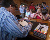 """Former Congressman and Fox News host John Kasich signs copies of his new book, """"Stand for Something"""", in the Westerville Public Library reproduction of his Washington office. The library opened Sunday, June 11, 2006, the offices containing Kasich's historical records and personal library from his years as a U.S. congressman.<br />"""