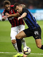 Calcio, Serie A: Inter Milano - AC Milan , Giuseppe Meazza stadium, .October 21, 2018.<br /> Inter's Ivan Perisic (r) in action with Milan's Luca Biglia (l) during the Italian Serie A football match between Inter and Milan at Giuseppe Meazza (San Siro) stadium, October 21, 2018.<br /> UPDATE IMAGES PRESS/Isabella Bonotto