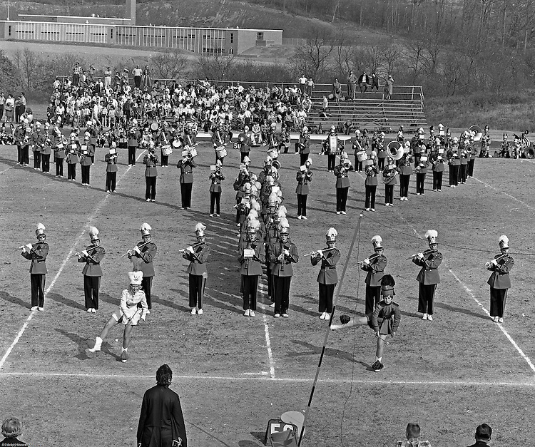 Bethel Park PA:  View of the Bethel Park High School Band and Majorettes performing during half-time of the Bethel Park Blackhawks vs the Elizabeth Forward Warrior football game.