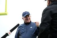 CHAPEL HILL, NC - OCTOBER 10: North Carolina head coach Mack Brown fist bumps a member of the ESPN crew before a game between Virginia Tech and North Carolina at Kenan Memorial Stadium on October 10, 2020 in Chapel Hill, North Carolina.