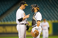 Starting pitcher Zack Godley #15 of the Tennessee Volunteers goes over signals with Wes Walker #44 during the game against the Texas Longhorns at Minute Maid Park on March 3, 2012 in Houston, Texas.  The Volunteers defeated the Longhorns 5-4.  Brian Westerholt / Four Seam Images