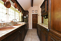 BNPS.co.uk (01202 558833)<br /> Pic:  Riverhomes/BNPS<br /> <br /> Pictured: The kitchen.<br /> <br /> A striking Victorian boathouse that has been used as a film set is on the market for £2m.<br /> <br /> The time capsule building by the River Thames was used in a film version of The Wind in the Willows and the 1996 film True Blue, about the Oxford Cambridge boat race.<br /> <br /> It has an enclosed mooring as well as two moorings on the bank, perfect for those who want to spend their days messing about in boats like Ratty and Mole.