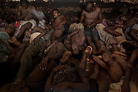 Prisoners sleeping on the floor in Pademba Central Prison. Up to 60 prisoners share a 25 square metre cell for up to 16 hours. They use a bucket in the cell as a toilet. Most prisoners have scabies and other skin conditions. They often spend 8 months without a shower and are only given very little drinking water. .