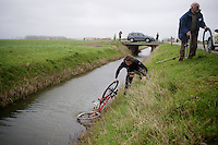 Gert Steegmans (BEL/Trek Factory Racing) was simply blown into a ditch 2 meters down, off the road by the fierce winds (up to 80km/h) in the infamous Moeren.<br /> His bike went under and the team mechanic had to go fish it out. Steegmans abandoned at the spot with an injury in the face. <br /> <br /> 77th Gent-Wevelgem 2015