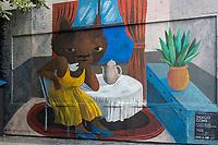 """Europe/ Ile de France / Paris /75011 :  Thiago Goms :Une vie de chat. Thiago Goms (1984), artiste brésilien, street artiste, devant le « Mur » qu'il a réalisé en septembre 2018 rue Oberkampf à Paris<br /> Le mur d'Oberkampf- ce pari fou devenu une institution du street art parisien  sur l'immeuble de l'historique Café Charbon, L'association le M.U.R. (modulable, urbain, réactif)  _ Oeuvre protégée  //  Europe / Ile de France / Paris / 75011: Thiago Goms (b. 1984), Brazlian artist, street artist, in front of the """"Wall"""" he realized on September 2018 in Paris, rue Oberkampf -  The Oberkampf wall, this crazy gamble that has become an institution of Parisian street art on the building of the historic Café Charbon, The association M.U.R. (modular, urban, reactive) OP Protected work /"""