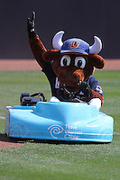 Durham Bulls mascot Wool E. Bull riding his go-cart during a game against the Louisville Bats at Durham Bulls Athletic Park on May 2, 2012 in Durham, North Carolina. Durham defeated Louisville by the score of 7-5. (Robert Gurganus/Four Seam Images)