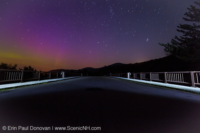 Franconia Notch State Park - Northern lights mixed with light pollution from the old U.S. Route 3 bridge along the Franconia Notch Bike Path in the White Mountains of New Hampshire.