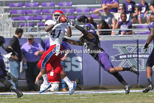Kansas Jayhawks tight end Jimmay Mundine (41) and  TCU Horned Frogs cornerback  Jason Verrett (2) in action during the game between the Kansas Jayhawks and the TCU Horned Frogs  at the Amon G. Carter Stadium in Fort Worth, Texas. TCU defeats Kansas 27 to 17.